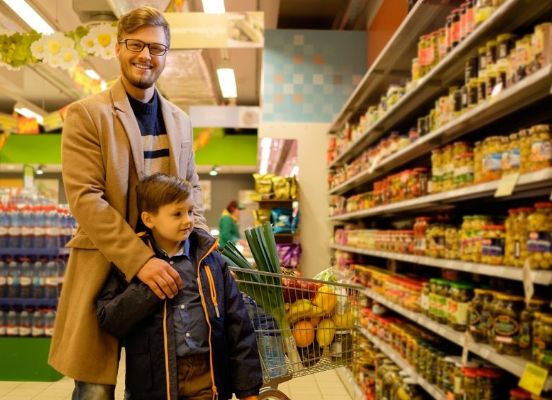 Dad and son in grocery store