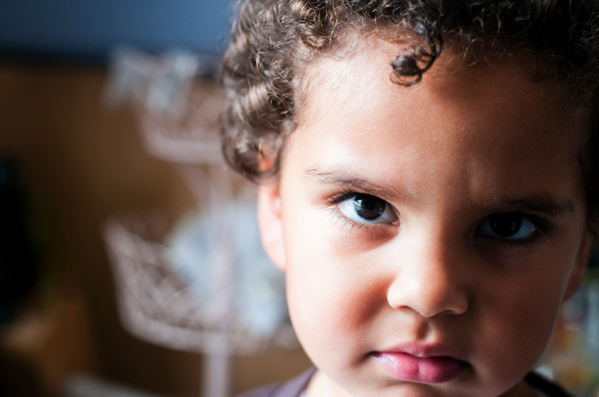 Royalty free stock photo of 2  years old girl looking very unhappyShot in Raw and Post-processed in ProPhoto RGB. No sharpening applied.  There is a