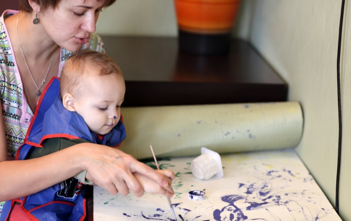 Mother with son drawing picture
